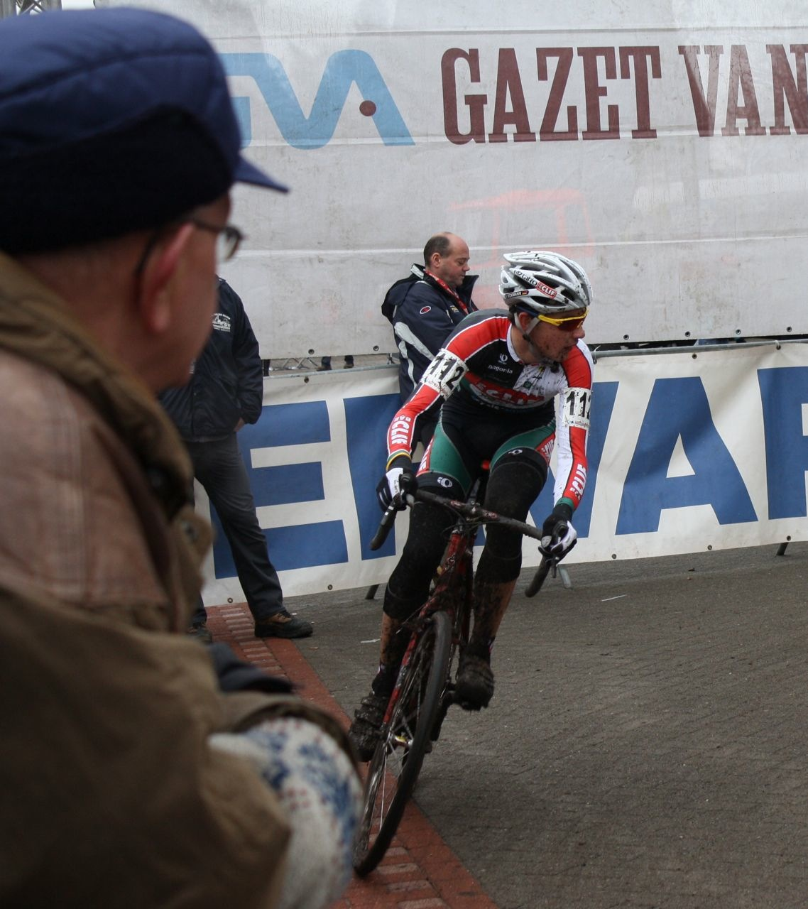 A Fan Watches Euro \'Cross Camper Yannick Eckmann turn onto the Road. ? Dan Seaton