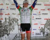 Katie in the leader's jersey on the podium © Amy Dykema