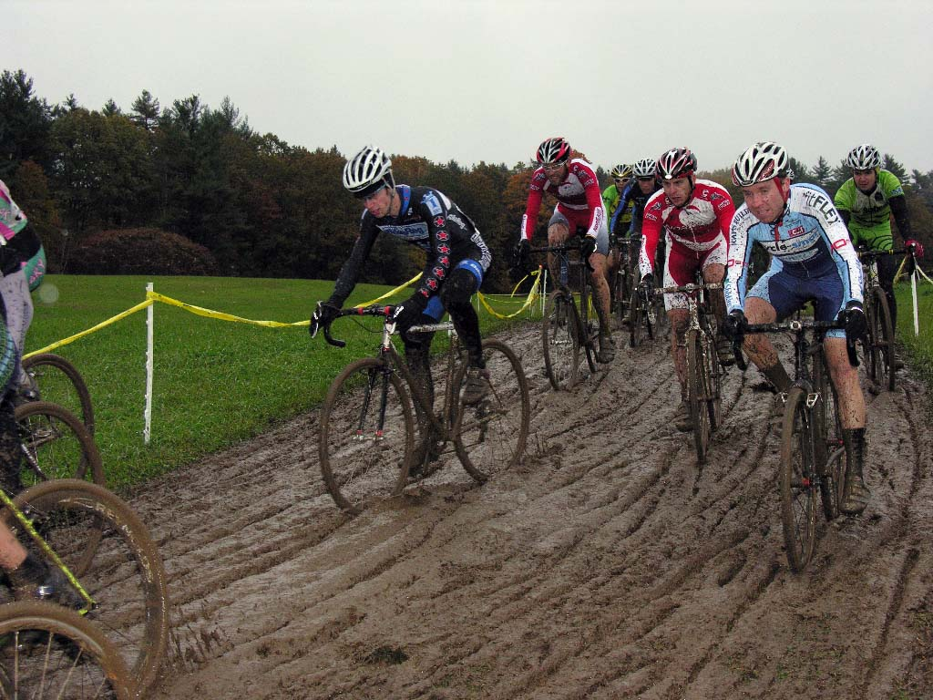 Elite men in 4 inches of thick mud on the first lap. ? Paul Weiss