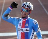 Zdenek Stybar is a happy champion giving a farewell present to T