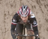 Another racer dives into the mud puddle at Raceway CX. © Karen Johanson