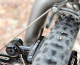 The Moots carbon cyclocross fork features indents by the brake pads for 2.5mm of pad clearance for both mud and easy wheel removal. © Cyclocross Magazine