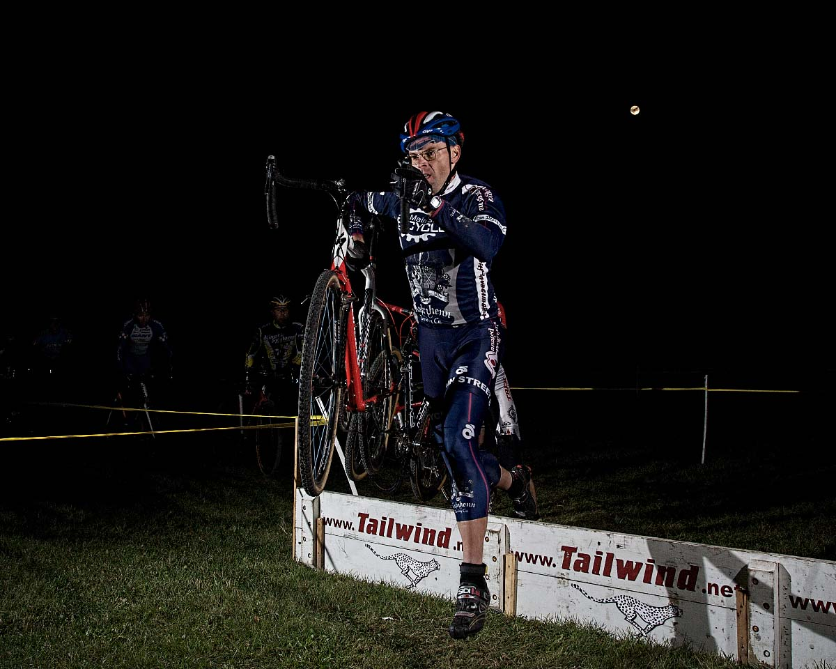 Rob Selle/Main Street Bicycles jumps the barriers under the moon. ? Andrea Tucker 2009/www.tuckerbikes.com