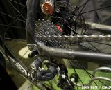 An aluminum derailleur hanger fits on the shaped carbon chainstay to seatstay joint. © Kevin White