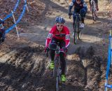 Emma White (Cyclocrossworld.com), center, and Laura Van Gilder (Van Dessel p/b Mellow Mushroom) take different lines through the mud. © Todd Prekaski