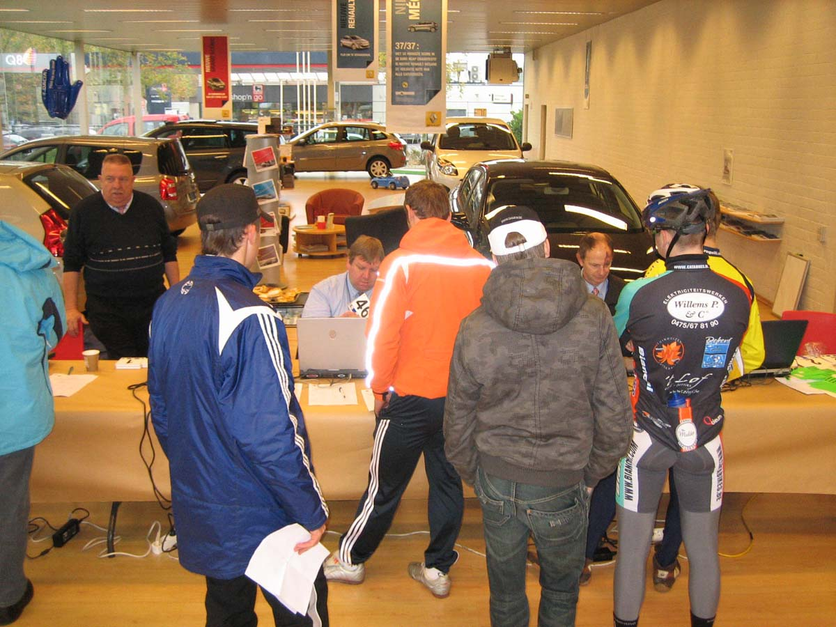 Jaarmaarktcross registration was held in a car dealership showroom.   ? Christine Vardaros