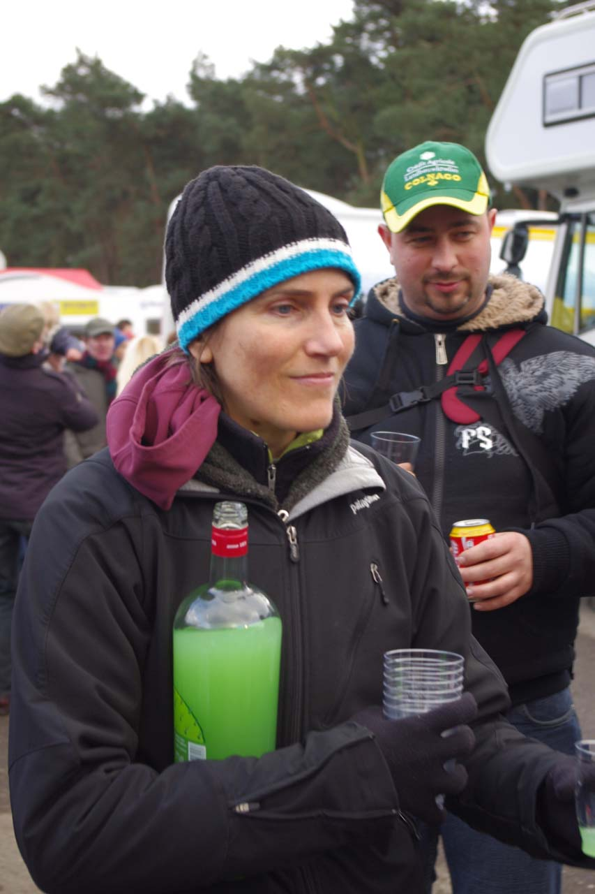 Vardaros hands out recovery drinks after the race. ? Jonas Bruffaerts