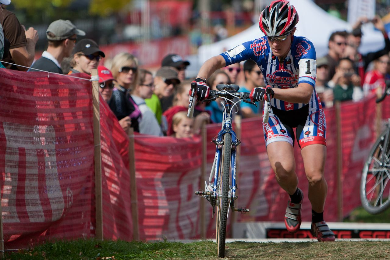 Katie Compton (Planet Bike) pulls away from the field in second lap action over the SRAM Service Course barrier section. By the third lap she was solidly away on her own. © Wil Matthews