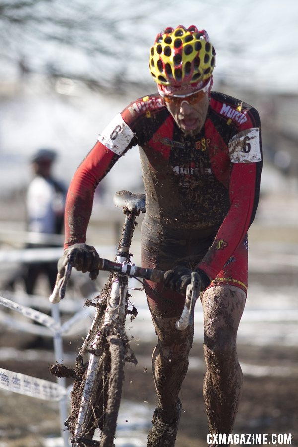 Pietro forced to run to the pits. Masters Men 40-44, 2013 Cyclocross World Championships. © Cyclocross Magazine
