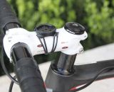 Jacobs' white Easton EA90 stem stands out against the black bike, and has a standard Garmin mount atop. The stem holds Easton's EA70 bar as well. Note the rear derailleur cable, with in-line barrel adjuster, running through the top tube. © Cyclocross Magazine