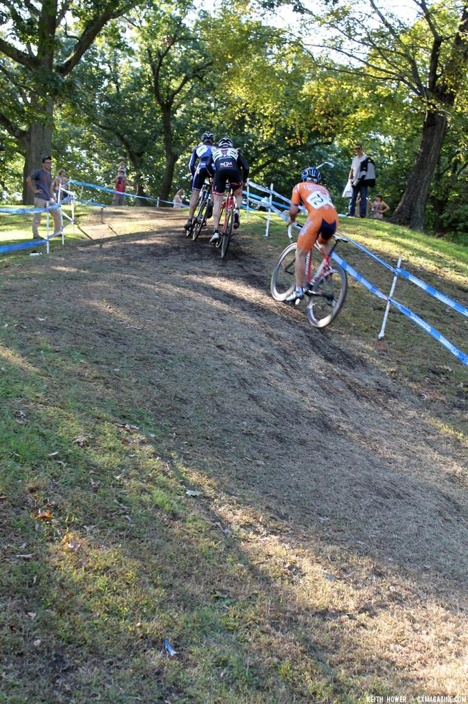 Several riders chase up the hill. © Cyclocross Magazine