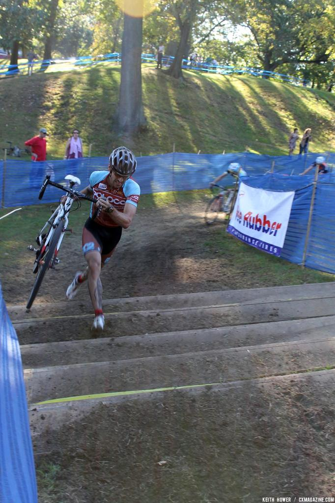A rider nears the top as the pack chases. © Cyclocross Magazine