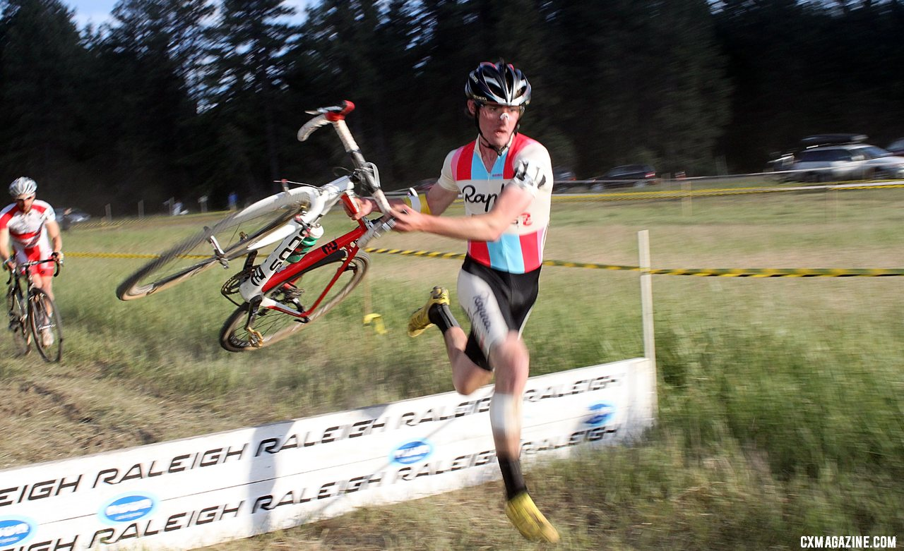 McDonald hits the barrier with speed. Raleigh Midsummer Night\'s cyclocross race. © Cyclocross Magazine