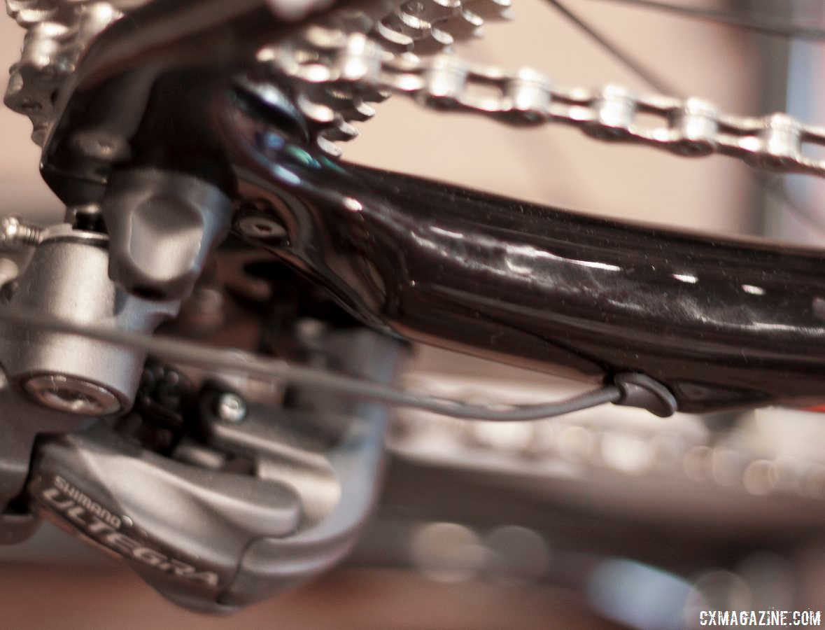 The wiring for the Shimano Ultegra Di2 RD-6770 exits neatly from the drive-side chain stay, and a rubber stop should keep the mud and dirt out. © Cyclocross Magazine