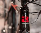 A nude but glossy carbon finish on the 2014 Conquest Team might save a few ounces. © Cyclocross Magazine