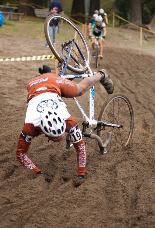 The sand proved too move for this Counterbalance Bicycles racer who went over the bars © Karen Johanson