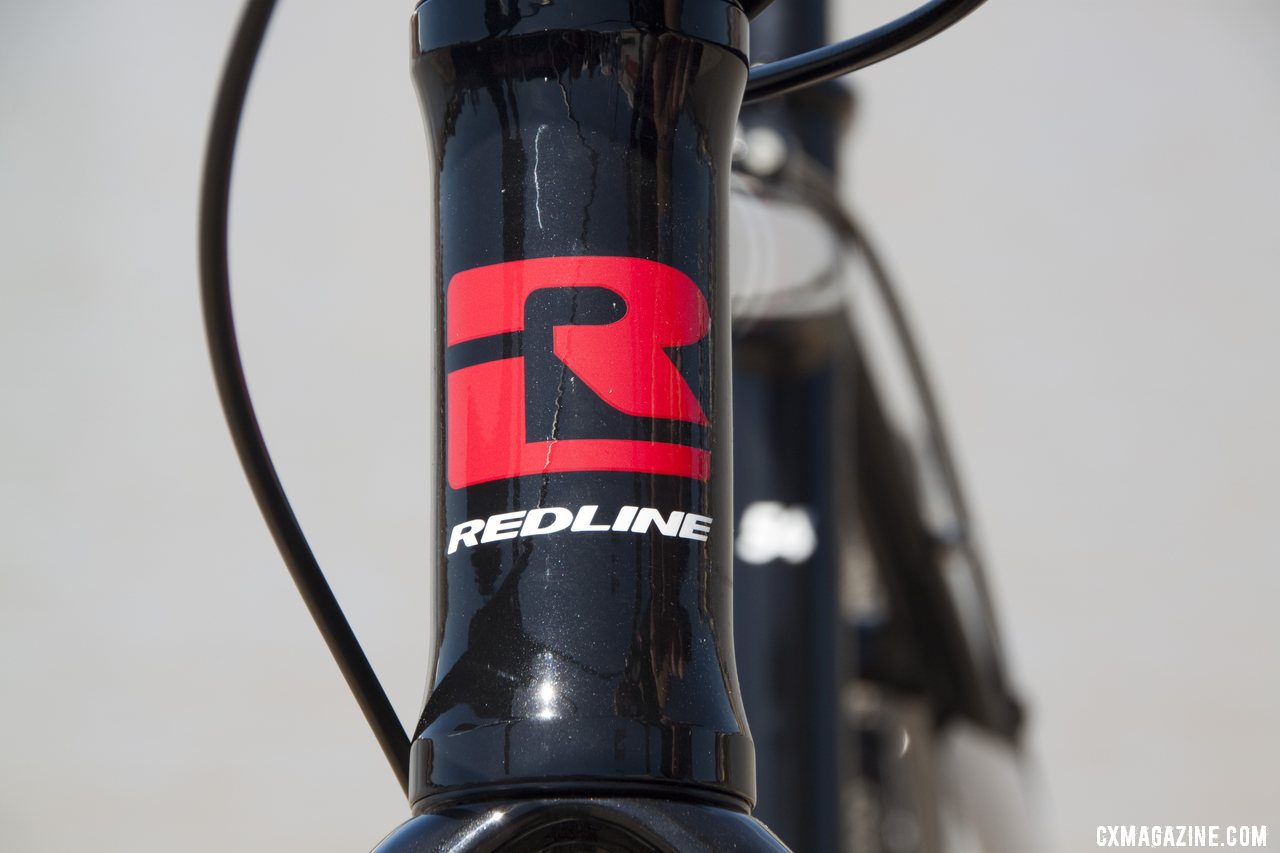 Redline\'s new bold head badge for 2013. Sea Otter 2012. ©Cyclocross Magazine