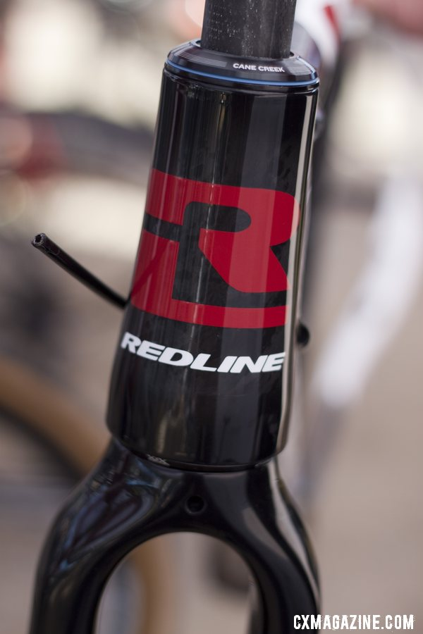 We got an exclusive preview of Redline 2013 products, but currently this bold head badge is all we\'re allowed to show you. Sea Otter 2012. ©Cyclocross Magazine