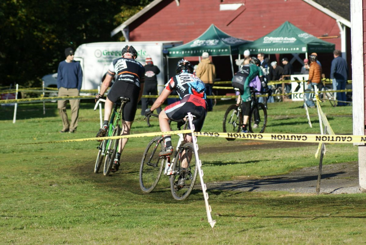 Masters racers ride the barn area © Kenton Berg