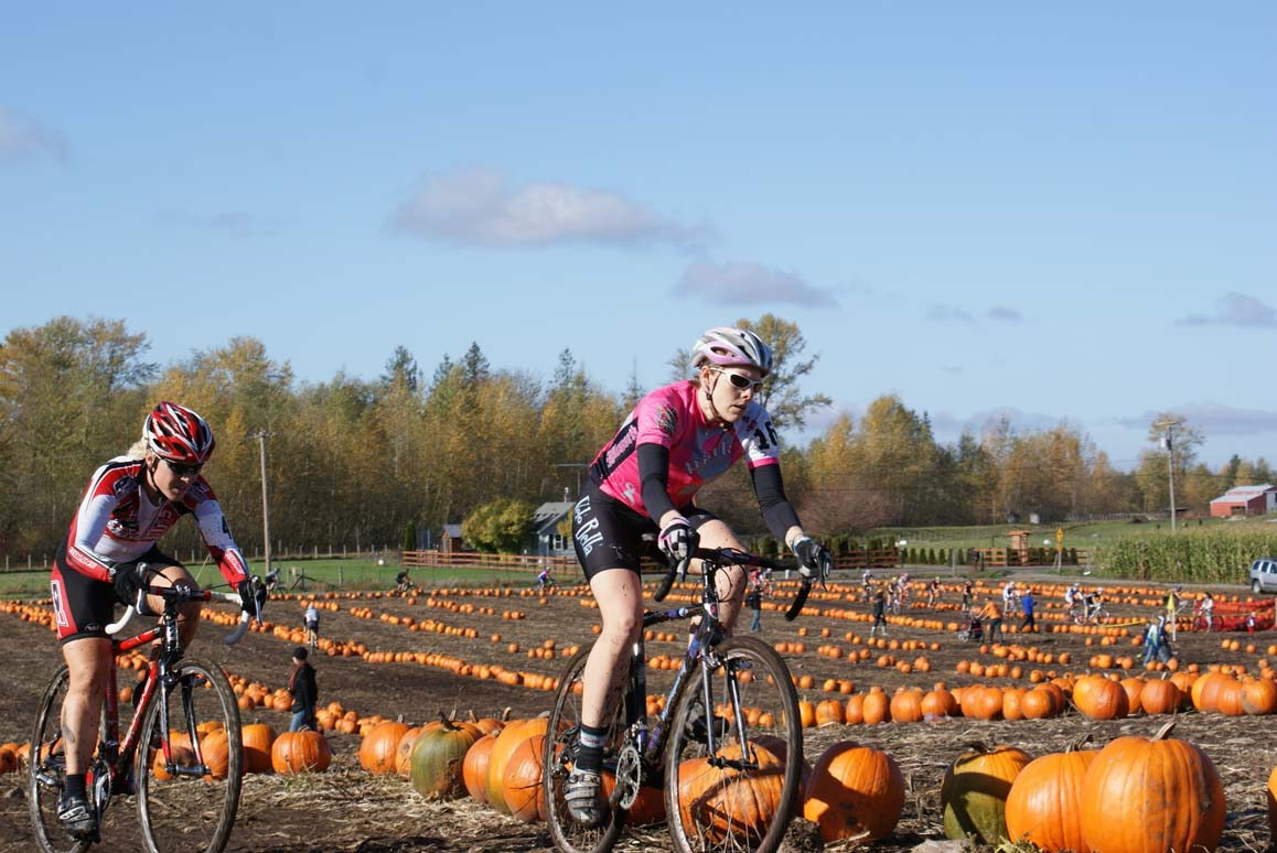Kristi Berg (Redline) and Keri Studley (Velo Bella) duked it out early in the women's elite race. Seattle Cyclocross #5, Maris Farm, November 1, 2009. ? Kenton Berg
