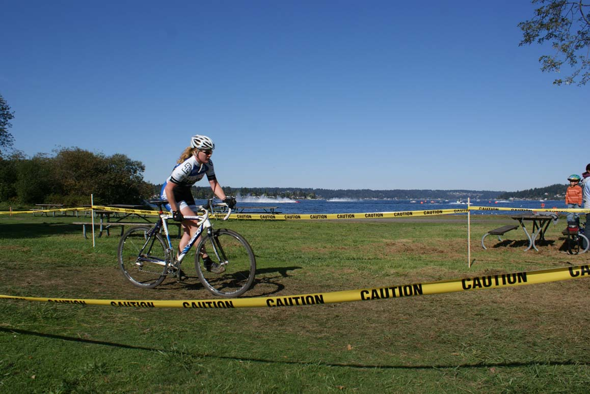 Women's racer readies for the barriers with Hydro's in background. by Kenton Berg