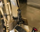 Six Eleven Bicycle Co.'s added a fork-mounted cable hanger to the Wound Up carbon cross fork.  NAHBS 2012. ©Cyclocross Magazine