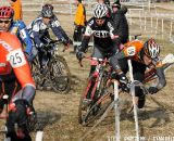 Joe Fabris of Plus 3 Network gets taken down but not out on the first lap of the mens 50-54 race. ©Steve Anderson