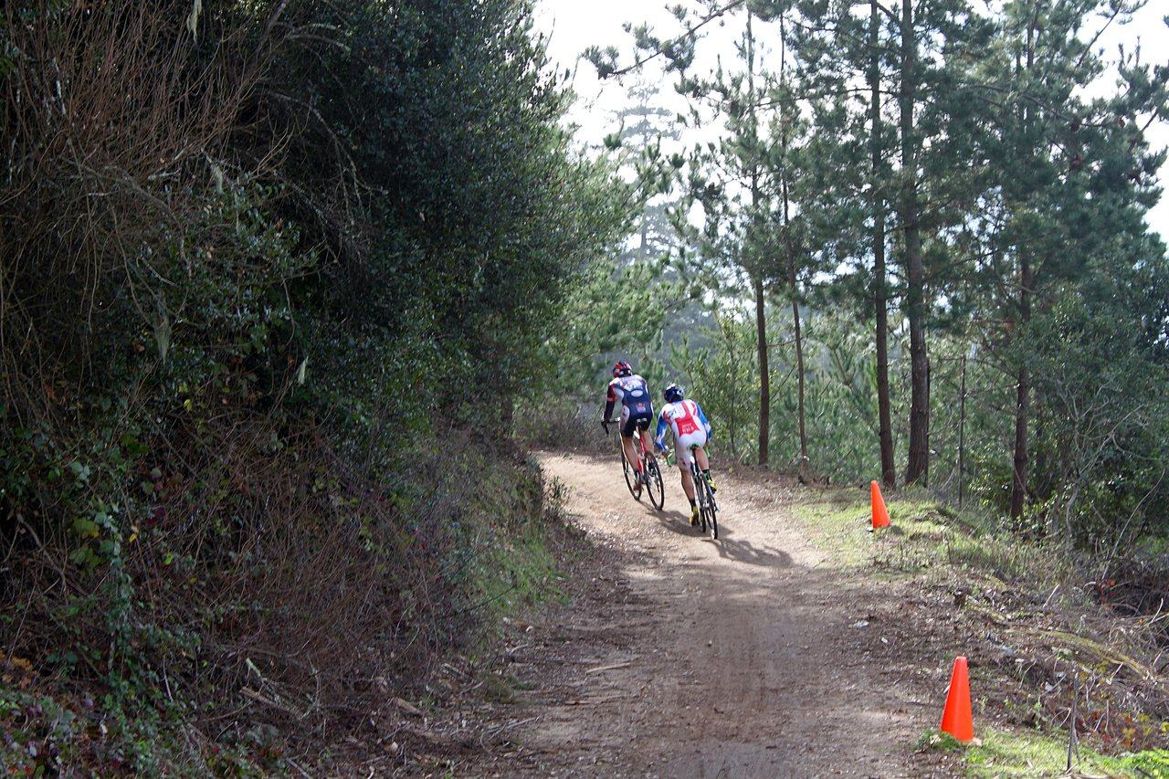 Johnson sits on Robinson's wheel on lap 1. Surf City Cyclocross Series Finale, Aptos High School, 1/10/10. ? Cyclocross Magazine