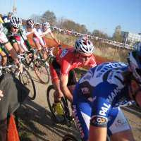 jonathan on niels albert wheel onto dirt first lap - rob peeters behind as is christian heule on right with swiss natl jersey