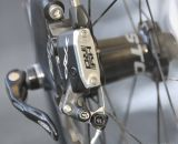 The TRP HY-RD cable-actuated hydraulic disc brake features a locking thumbscrew to aid in setup and avoid accidental piston displacement when a wheel and rotor aren't in place. © Cyclocross Magazine