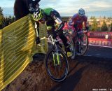 Driscoll takes the run-up smoothly while the rider behind him stumbles. © Cyclocross Magazine