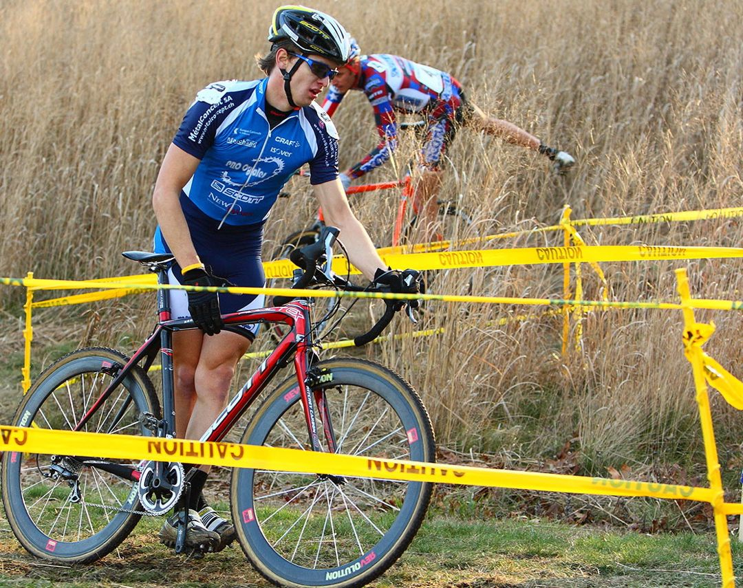 Swiss cyclocross star Valentin Schrez leads Ryan Trebon over the barriers.  ?Anthony Skorochod