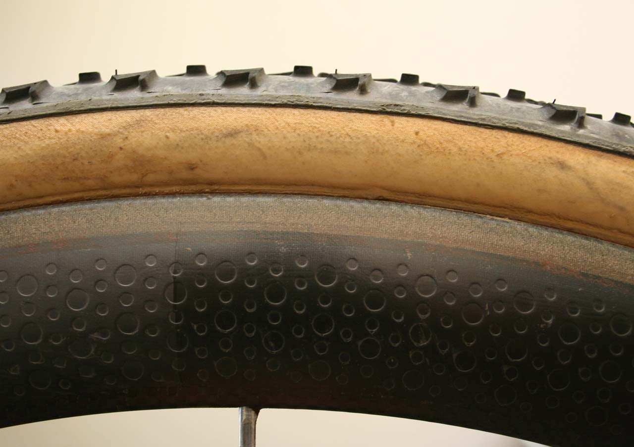 The 303\'s wider rim provides extra gluing surface area and almost covers the entire base tape. ? Cyclocross Magazine