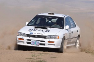 "Carl Decker and Adam Craig pilot ""Wheels of Teal"" through the national rally circuit © Jim Culp/ProRallyPix.com"