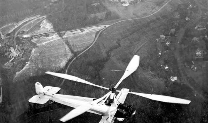 "Undated historical photo:  Aviation pioneer Harold Pitcairn flying a Cierva C8W ""autogiro"" above the site of this weekend's WhirlyBird 'Cross."