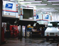 Is this why they're taking so long? USPS trucks being repaired. by flickr user: spatulated