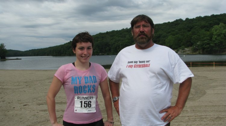 Dad and I after a triathlon- yeah, my shirt says My Dad Rocks. © Molly Hurford