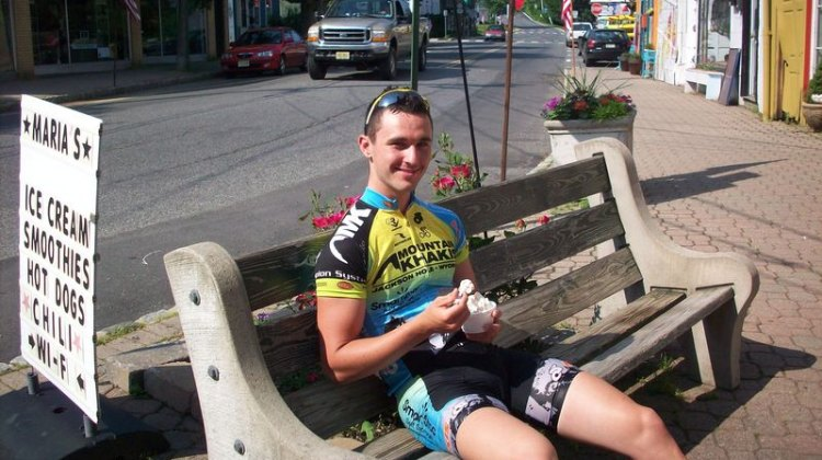 Luke Keough relaxes during a mid-ride ice cream break. © Molly Hurford