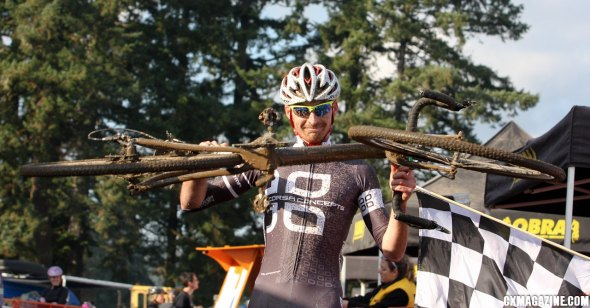 Aaron Tuckerman hoists his bike at the finish line after wining Cross Crusade #7 Sunday. ©Pat Malach
