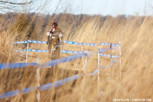 Mellisa Putzer in the tall grass.  ©Brian Nelson