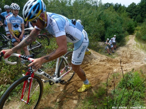 Adam Myerson shows off his remounting skills after the sandy runup. © Cyclocross Magazine