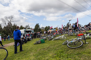 Brian addressing the crowd and racers. © Brian Mangano