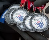 Participant medals are readied for all who finish the UCI Masters Cyclocross World Championships.