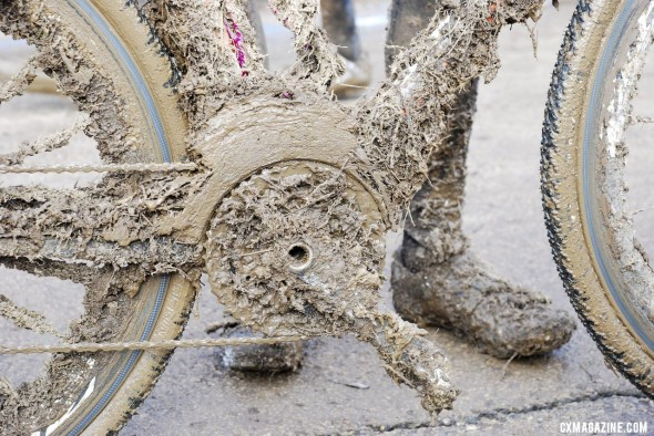 Serious, world-class mud in the junior race required pitting if you were lucky to have a pit bike.  © Cycl