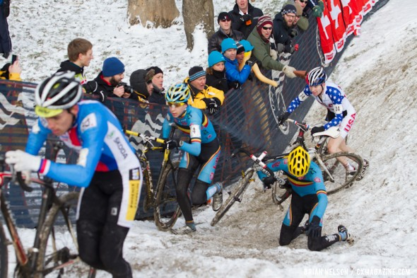 The Belgian rider goes down and Logan Owen chases at the Elite World Championships of Cyclocross 2013. © Brian Nelson
