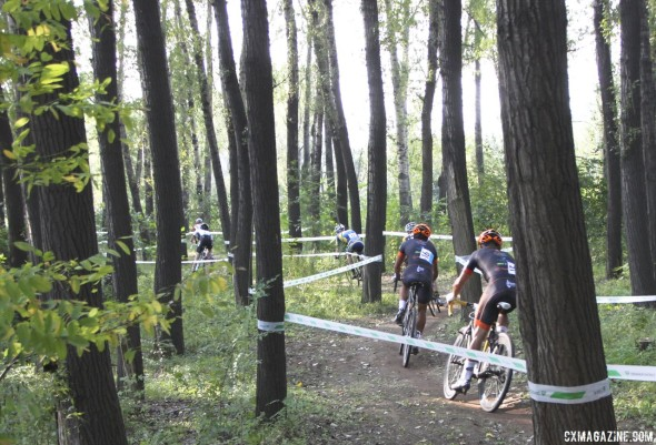 Schempf leading his Seavs/Haymarket teammate Nieter through the woods. Elite Men, Qiansen Trophy UCI C2 Cyclocross Event. © Cyclocross Magazine