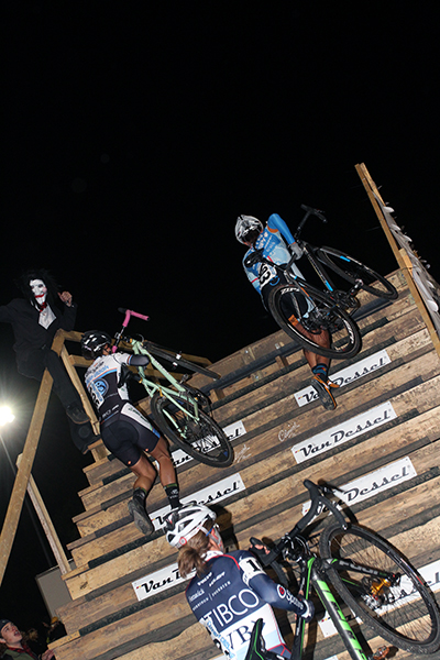 Women head up the steps under the lights at the Gateway Cross Cup. © Matt James