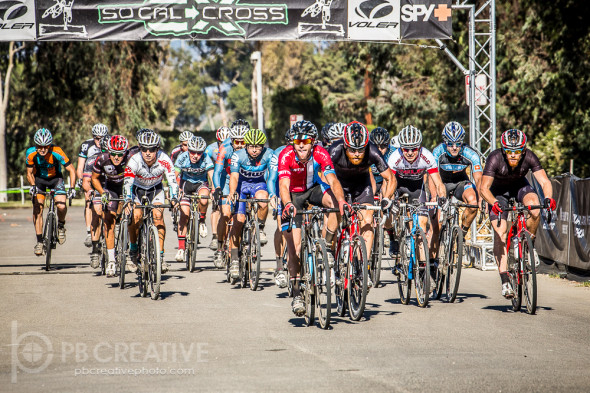 The Men's Elite field heads for turn one. © Philip Beckman