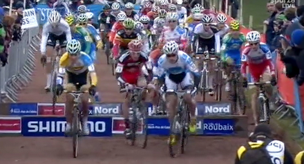 Screenshot from 2012 Roubaix Cyclocross World Cup, riding around barriers.
