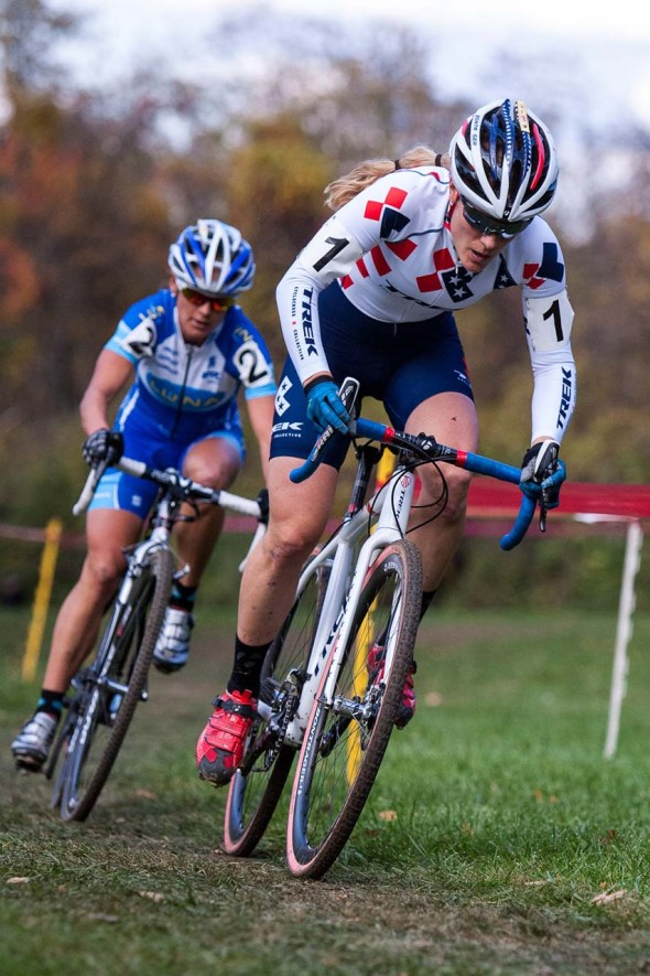 Katie Compton, foreground, out of the saddle on the attack, followed by Katerina Nash. © Kent Baumgardt